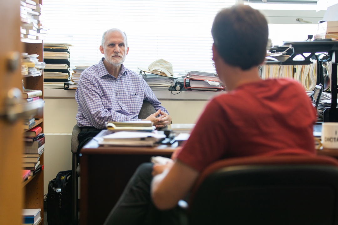 A student speaks with Professor Bruce Dickson