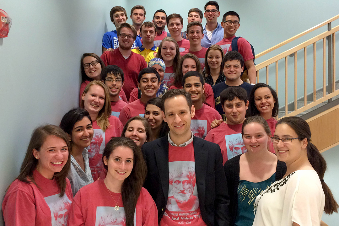 A group of students in the Politics and Values Program standing together on a stairway.